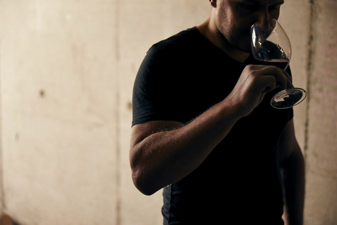 Man drinking Beaujolais wine