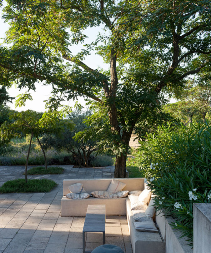 Garden seating area at John Hegarty's home