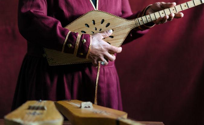 Musician playing the panduri - a traditional Georgian instrument