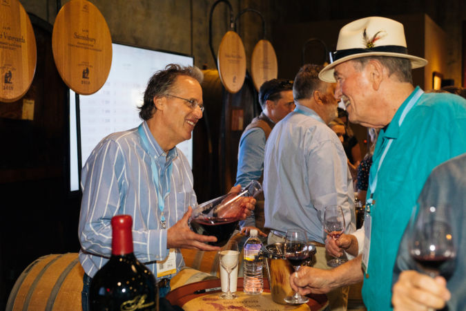 Doug Shafer pouring at the Auction Napa Valley barrel tasting