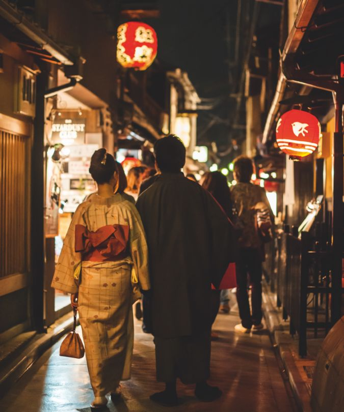 Couple walking in the Pontocho district, Kyoto