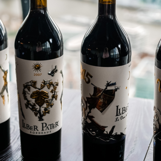 four wine bottles of Liber Pater in a row