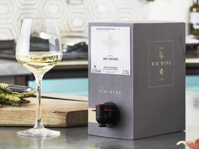 Boxed BIB wine on countertop with a glass of wine standing next to it