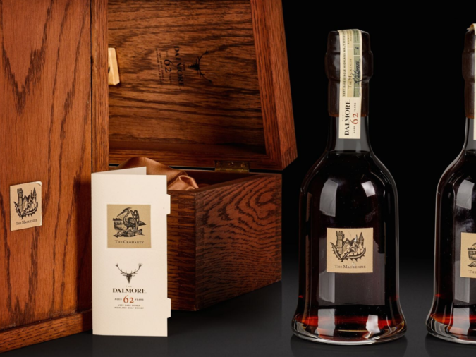 Dalmore whisky bottles next to wooden box casing