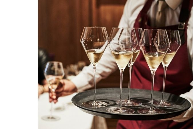 Sommelier with a tray of champagne glasses