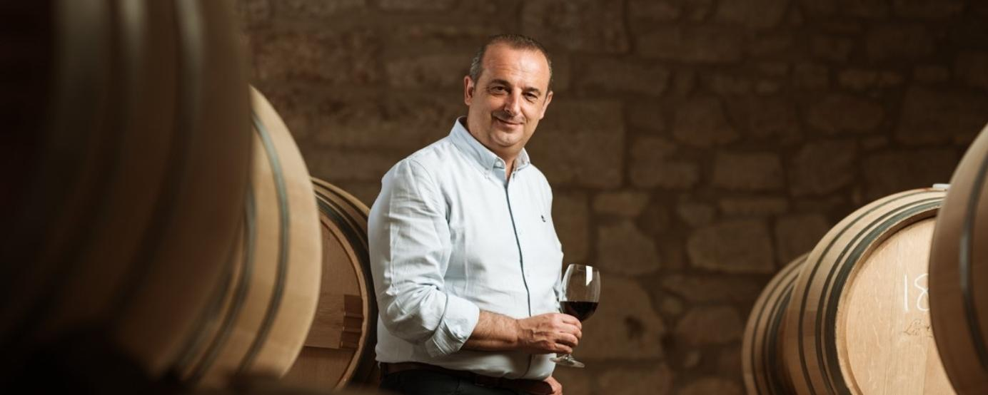 Julio Saenz with a glass of Rioja in hand