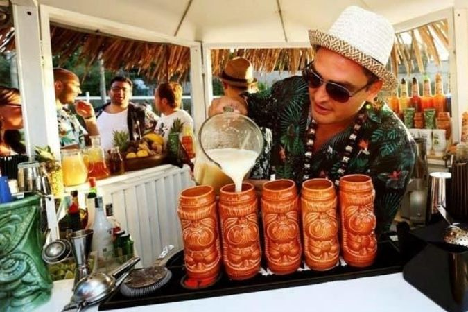 Pouring cocktails at a Tiki Bar