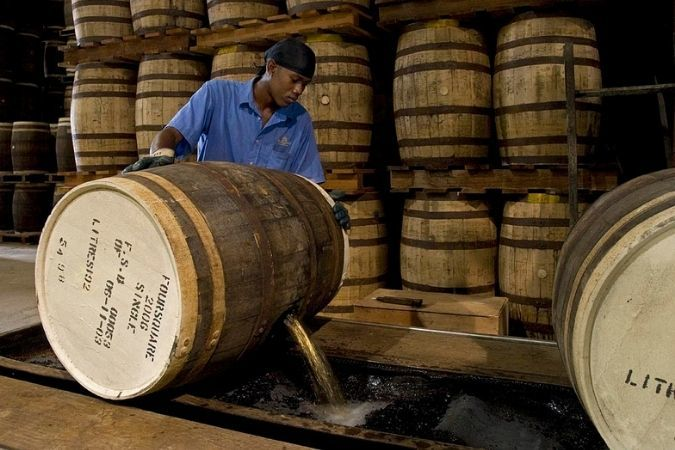 Pouring a barrel of rum at Foursquare Distillery