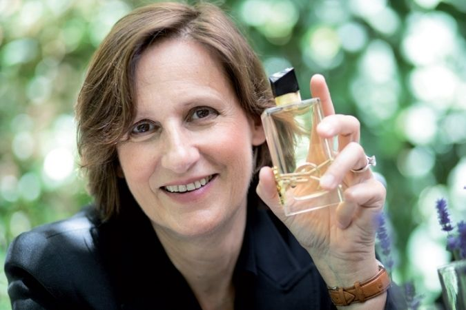 Anne Flipo with a bottle of her perfume