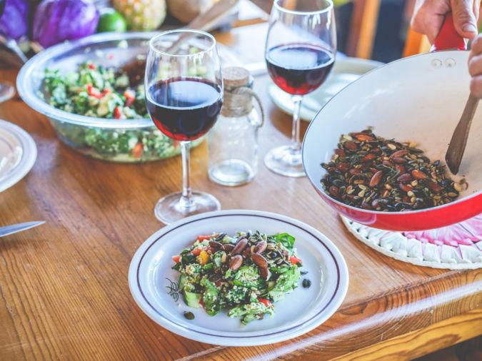 Male chef serving organic vegan salad for dinner