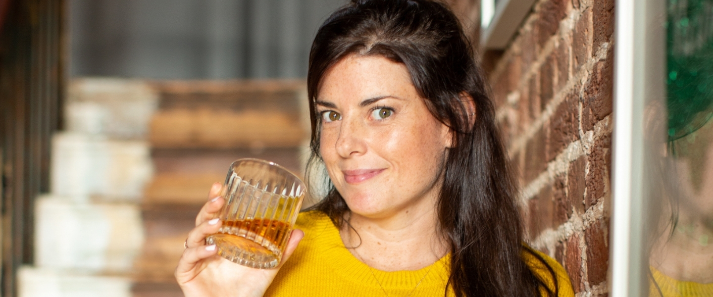 Becky Paskin drinking a glass of whisky