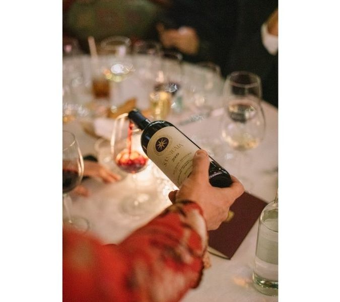 A bottle of sassicaia 2009 being poured