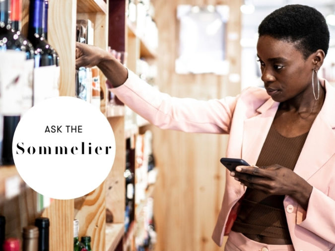 lady viewing wine in shop