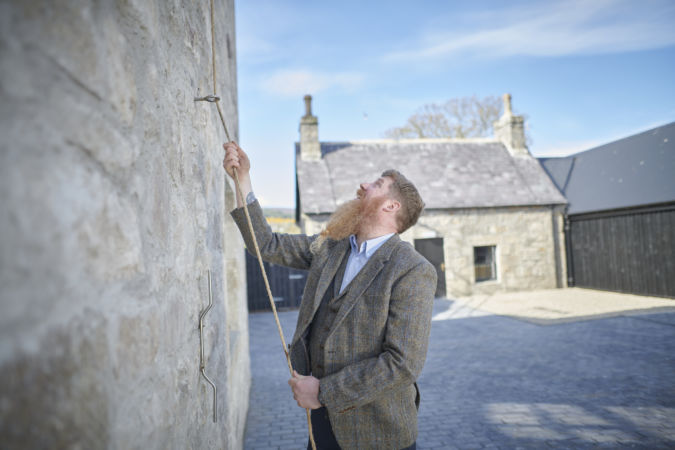 Stewart Bowman ringing the bell at Brora distillery