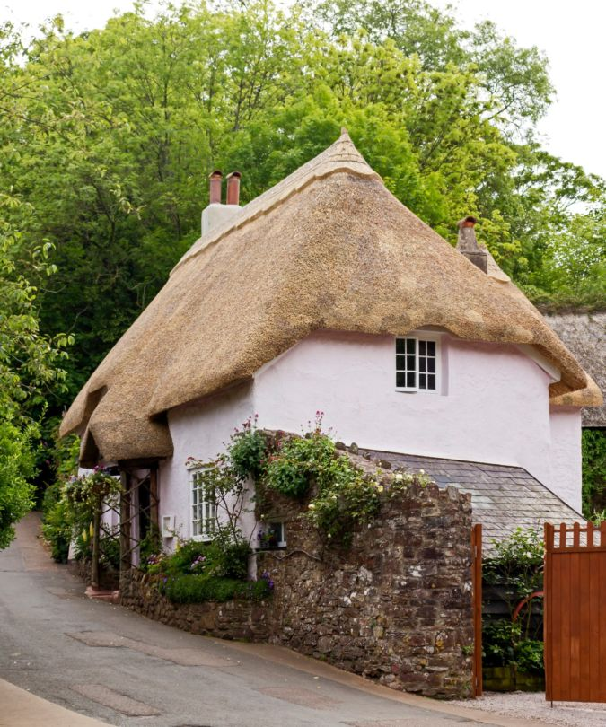 A pink thatched house in Cockington in the English Riviera