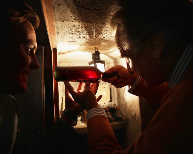 Checking bottles in the Biondi-Santi cellar