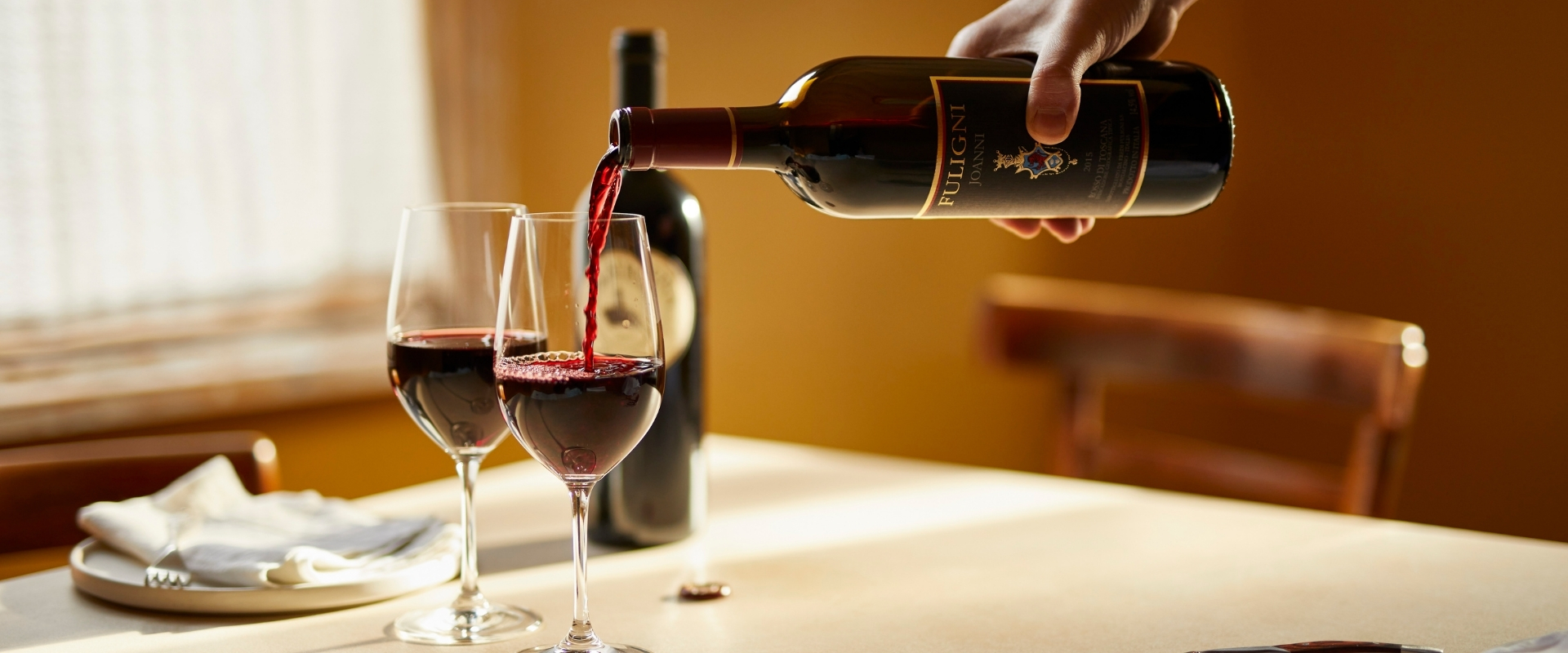 Super-Tuscan wine being poured into a glass
