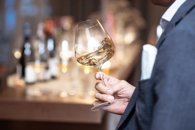 white wine swirling in a glass