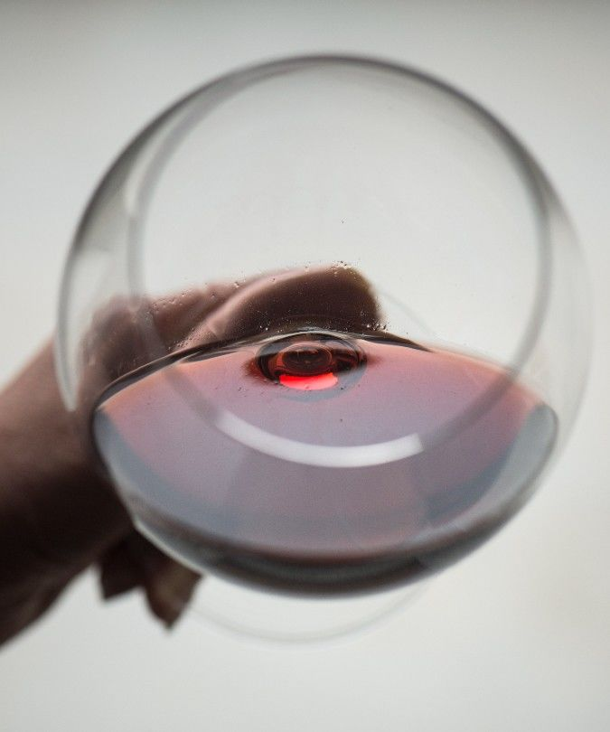 a glass of barolo in hand