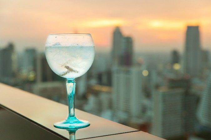 gin and tonic with rooftop bar view