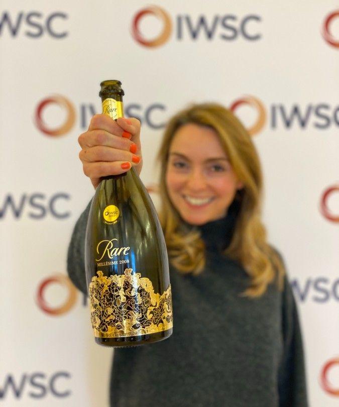 helena nicklin holding Rare champagne