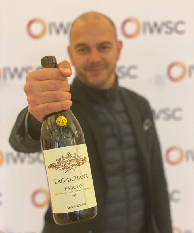 Nicolas Clerc MS holding Barolo bottle at IWSC judging