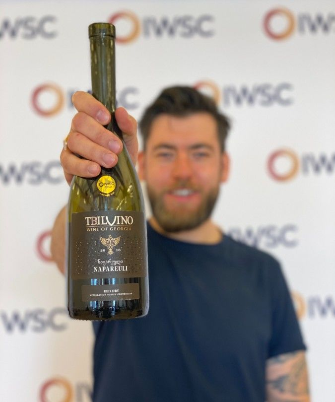 freddy bulmer holding georgian wine at iwsc 2021