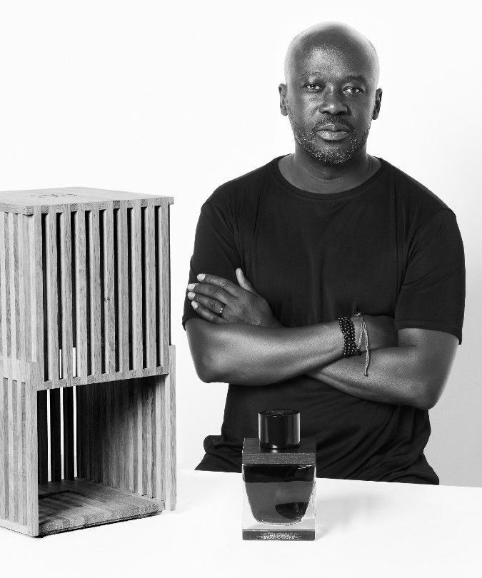 sir david adjaye with decanter and case for 80 year old whisky