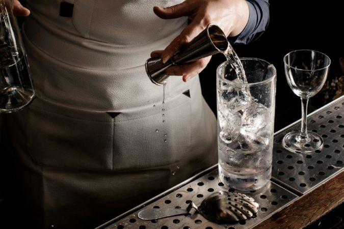 bartending making vodka cocktail at bar