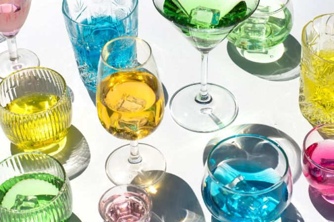 range of colourful liqueurs in glasses
