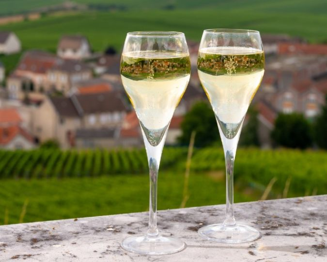 champagne glasses with view of french vineyards